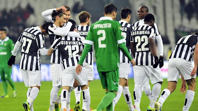 Juventus forward Sebastian Giovinco, back to camera, celebrates with teammates after scoring during an Italian Cup soccer match between Juventus and Avellino at the Juventus stadium, in Turin, Italy, Wednesday, Dec. 18, 2013