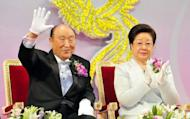 This handout photo from the Segye Times shows Reverend Sun Myung Moon (L), the founder of the Unification Church, and his wife Han Hak-Ja, blessing newlyweds during a mass wedding ceremony organized by the church at a sprawling exhibition centre in Goyang, north of Seoul, in 2010. Moon is in a hospital in critical condition due to complications from pneumonia, according to his spokesman