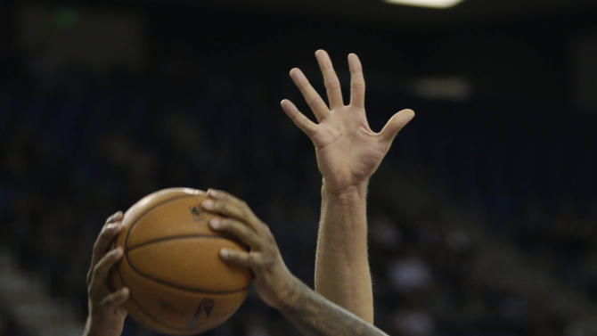 Sacramento Kings center DeMarcus Cousins, left, grabs a rebound against Brooklyn Nets center Brook Lopez during the first quarter of an NBA basketball game in Sacramento, Calif., Wednesday, Nov. 13, 2013.  The Kings won 107-86