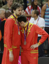 Spain's Pau Gasol, left, and Rudy Fernandez react after getting their silver medal following a ceremony at the 2012 Summer Olympics, Sunday, Aug. 12, 2012, in London. (AP Photo/Matt Slocum)