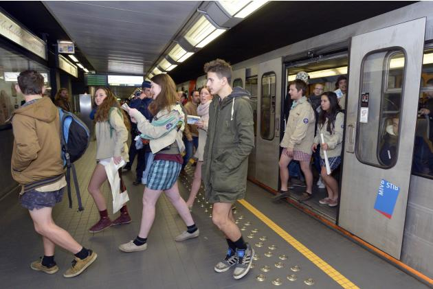 "People take part in the annual ""No Pants Subway Ride"" in the subway in Brussels"