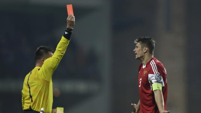 Referee Goecek of Turkey shows a red card to Belarus' Martynovich during their Euro 2016 qualifying soccer match in Zilina