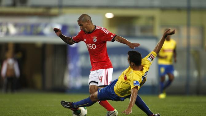 Benfica's Lima fights for the ball with Estoril's Fernandes during Portuguese Premier League soccer match in Estoril