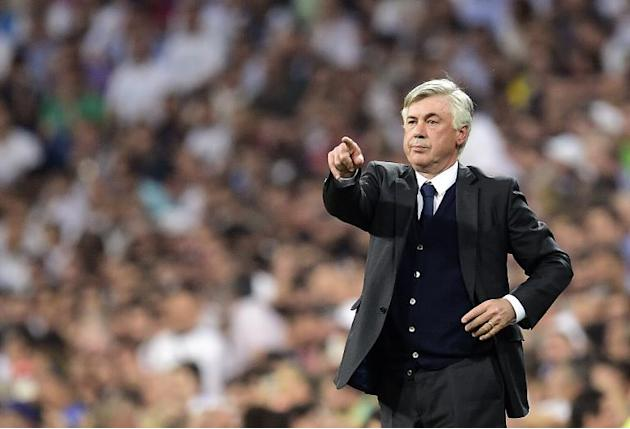 Real Madrid's Italian coach Carlo Ancelotti gestures during the UEFA Champions League semi-final second leg football match Real Madrid vs Juventus in Madrid on May 13, 2015