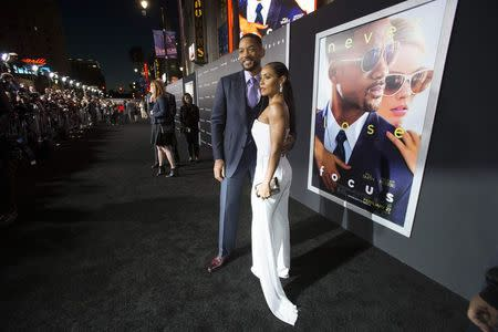 "Cast member Smith and his wife Jada pose at the premiere of ""Focus"" at the TCL Chinese theatre in Hollywood"