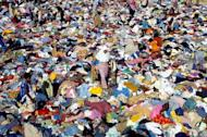 A 2005 file photo showing Indonesian survivors of the 2004 tsunami disaster selecting used clothing. An Indonesian girl separated from her family during the tsunami has been reunited with her family after seven years as a street child