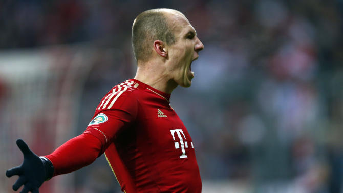 Arjen Robben of Bayern Munich celebrates his goal against Borussia Dortmund during their German soccer cup, DFB Pokal, quarter-final soccer match in Munich