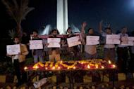 People attend a candlelight vigil for the victims of Monday's suicide bombing in Lahore, Tuesday, Feb. 14, 2017 in Karachi, Pakistan. Pakistan's cultural capital of Lahore on Tuesday mourned the victims of a suicide bombing the previous day that killed 13 people. Markets and businesses remained closed across much of the country's eastern Punjab province while flags at government buildings are at half-staff. (AP Photo/Shakil Adil)