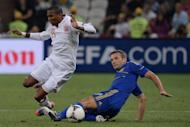 Andriy Shevchenko (right) takes on England's Ashley Young during the Euro 2012 match in Donetsk on June 19. Shevchenko on Saturday said he is joining a pro-business political party after announcing that he was quitting football for politics