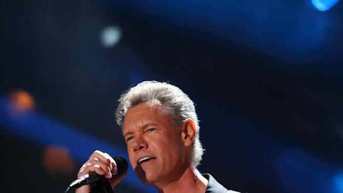 FILE - In this June 7, 2013 file photo, Randy Travis performs at the 2013 CMA Music Festival at LP Field in Nashville Tenn. Travis has been hospitalized in Texas with viral cardiomyopathy. A news release from the singer's publicist says Travis was admitted to the hospital Sunday, July 7, 2013, in Dallas. (Photo by John Davisson/Invision/AP, File)