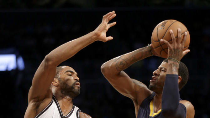 Indiana Pacers' Paul George, right, shoots over Brooklyn Nets' Alan Anderson during the first half of an NBA basketball game Monday, Dec. 23, 2013 in New York