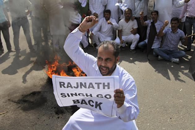 Activists of Jammu and Kashmir National Panthers Party shout slogans during a shutdown in Jammu, India, Wednesday, May 27, 2015. Closed markets and empty roads greeted India's Home Minister Rajnath Si