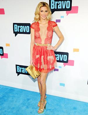 Brandi Glanville Flashes Cleavage in Outrageous Plunging Dress