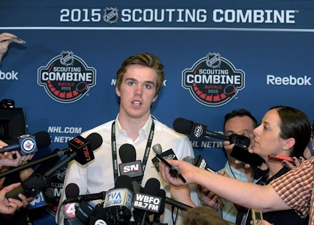 Connor McDavid pauses when he is asked about all the media attention he is getting during a news conference at the NHL Combine in Buffalo, N.Y., on June 5, 2015. Wayne Gretzky can't offer Connor McDavid much advice about how to handle the pressure of the NHL draft later this month. The Great One never went through the experience himself. But on June 26, he'll be watching with interest from his summer home in Idaho as the Edmonton Oilers, his former team, select first overall and likely take the highly touted McDavid. THE CANADIAN PRESS/AP, Gary Wiepert