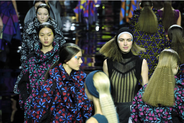 Models wear creations for Issey Miyake's fall-winter  2015-2016 Ready-to-Wear fashion collection, presented during the Paris Fashion Week in Paris, France, Friday, March 6, 2015. (AP Photo/Zachari
