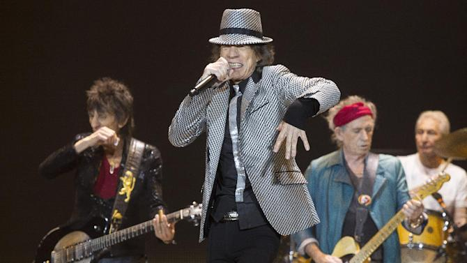 FILE - In this Nov. 25, 2012 file photo, Mick Jagger, center, Keith Richards, Ronnie Wood, left, and Charlie Watts, right, of The Rolling Stones perform at the O2 arena in east London. The Rolling Stones have been added to the list of artists performing at the 12-12-12 Hurricane Sandy benefit concert next week in New York City. Producers of the show said Friday, Dec. 7, 2012, had already raised $30 million that will be distributed to storm victims through the Robin Hood Foundation. The show is sold out. (Photo by Joel Ryan/Invision/AP)
