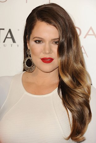 Khloe's stylist uses eyeshadow along her hairline to make her hair look fuller.