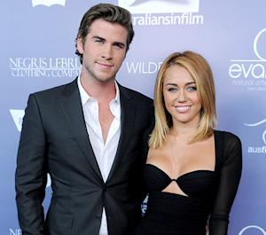 "Oops! Liam Hemsworth Says He and Miley Cyrus Are ""Married"""
