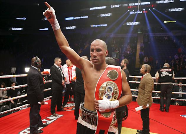 IBF super middleweight champion James DeGale of Britain celebrates his win over Canada's Lucian Bute following their IBF super middleweight title boxing match in Quebec City
