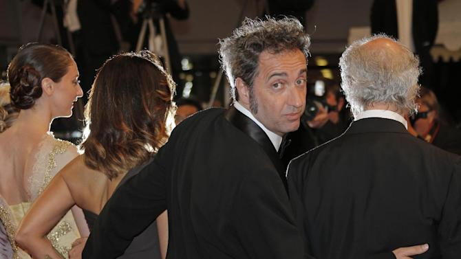 From second left, actress Sabrina Ferilli, director Paolo Sorrentino and actor Toni Servillo arrive for the screening of The Great Beauty at the 66th international film festival, in Cannes, southern France, Tuesday, May 21, 2013. (AP Photo/Lionel Cironneau)