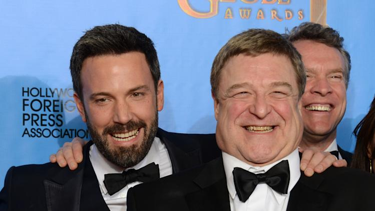 "Actor and director Ben Affleck, left, and actor John Goodman pose with the award for best motion picture - drama for ""Argo"" backstage at the 70th Annual Golden Globe Awards at the Beverly Hilton Hotel on Sunday Jan. 13, 2013, in Beverly Hills, Calif. (Photo by Jordan Strauss/Invision/AP)"