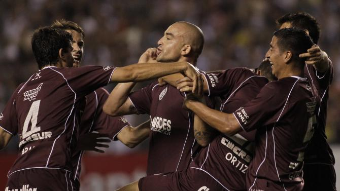 Silva of Argentina's Lanus celebrates with teammates after scoring a goal against Paraguay's Libertad during their Copa Sudamericana semifinal soccer match in Asuncion