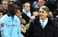 Mario Balotelli (left) and Manchester City manager Roberto Mancini at The Etihad Stadium earlier this month. Manchester City assistant manager David Platt insisted Monday he knew nothing about reports Balotelli was set to leave the Premier League champions