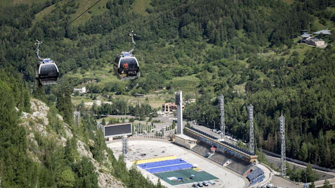People travel in cable cars above the Medeu skating oval in Almaty