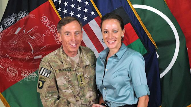 "FILE - This July 13, 2011, photo made available on the International Security Assistance Force's Flickr website shows the former Commander of International Security Assistance Force and U.S. Forces-Afghanistan Gen. Davis Petraeus, left, shaking hands with Paula Broadwell, co-author of his biography ""All In: The Education of General David Petraeus."" The affair between retired Army Gen. David Patraeus and author Paula Broadwell is but an extreme example of the love/hate history between biographers and their subjects. (AP Photo/ISAF, file)"