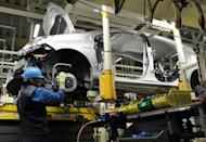 Toyota workers assemble a car at a factory in Japan. Japan's auto sector on Thursday reported huge increases in production for April from a year earlier, reflecting a steep recovery after last year's quake-tsunami disaster crippled output and demand