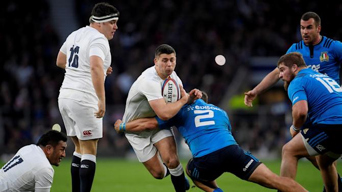 FILE PHOTO:  England's Ben Youngs in action with Italy's Ornel Gega