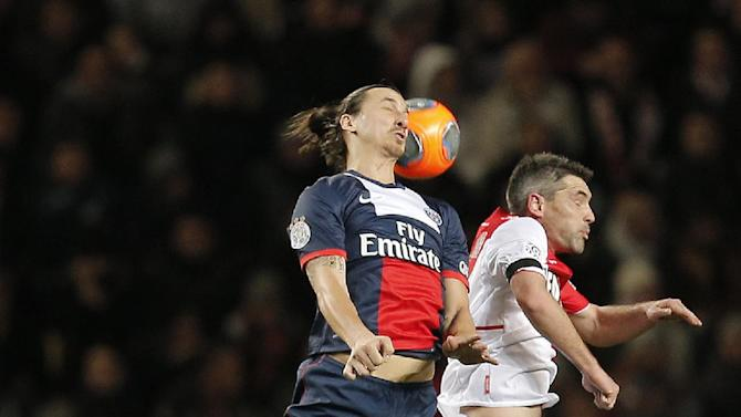 Paris Saint Germain's Zlatan Ibrahimovic of Sweden, left, challenges for the ball with Monaco's Joao Moutinho of Portugal during their French League One soccer match, in Monaco stadium, Sunday, Feb. 9 , 2014