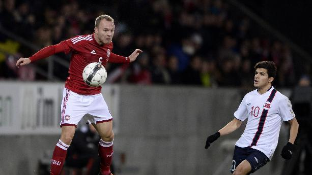 Denmark's Lars Jacobsen, left, competes for the ball and Norway's Tarik Elyounoussi during their international friendly match in Herning, Denmark, Friday, Nov. 15. 2013