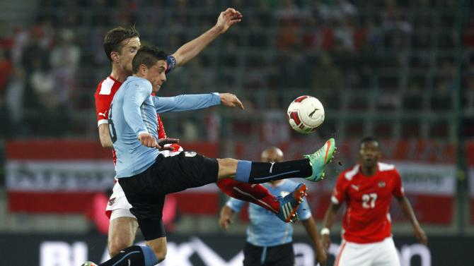 Austria's Janko and Uruguay's Jimenez fight for the ball during their international friendly soccer match in Klagenfurt