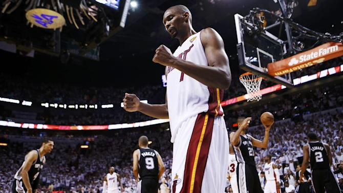 Basketball - Bosh officially re-signs with the Heat