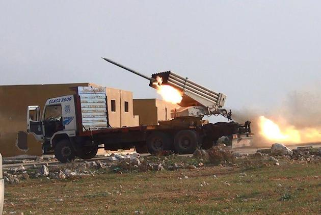 This photo provided by the anti-government activist group Aleppo Media Center (AMC), which has been authenticated based on its contents and other AP reporting, shows multiple rocket launchers fire Gra
