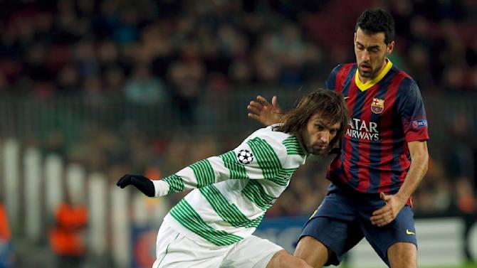 Celtic's Samaras is chased by Barcelona's Busquets during their Champions League soccer match in Barcelona