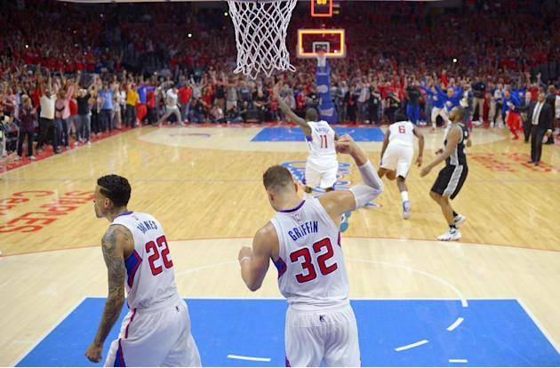 Los Angeles Clippers forward Blake Griffin, second from left, and forward Matt Barnes, left, celebrate alone with guard Jamal Crawford, center, as center DeAndre Jordan, second from right, grabs the b