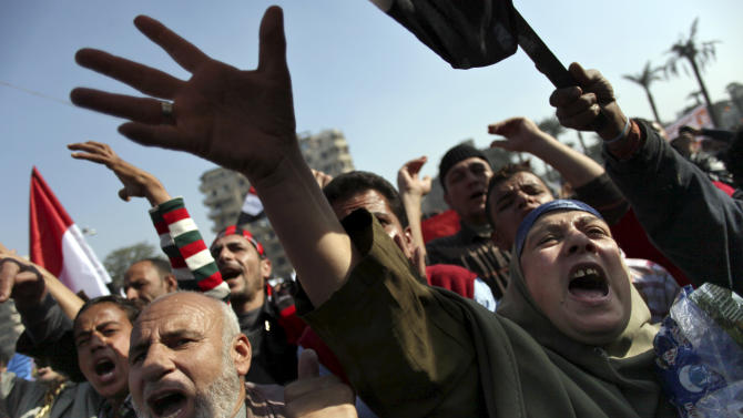 "Egyptian protesters chant anti-Muslim Brotherhood slogans as they attend a rally in Tahrir Square, in Cairo, Egypt, Friday, Nov. 30, 2012. Egypt's opposition has called for a major rally Friday in Cairo's Tahrir Square, where some demonstrators have camped out in tents since last week to protest decrees that President Mohammed Morsi issued to grant himself sweeping powers. Hundreds gathered in the plaza for traditional Friday prayers, then broke into chants of ""The people want to bring down the regime!"" — echoing the refrain of the Arab Spring revolts, but this time against a democratically elected leader. Other cities around Egypt braced for similar protests.(AP Photo/Khalil Hamra)"
