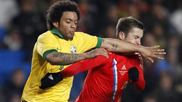 Brazil's Marcelo (L) vies with Russia's midfielder Victor Fayzulin (R) during the international friendly at Stamford Bridge (AFP)