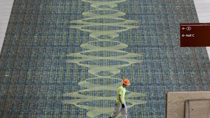 This April 12, 2013, photo shows carpet decorated with a sound wave in the Music City Center in Nashville, Tenn. Nashville's new convention center is transforming the look of downtown with its wavy roof dominating six city blocks, but tourism officials hope the eye-catching facility will also show business travelers a revitalized Music City. (A P Photo/Mark Humphrey)