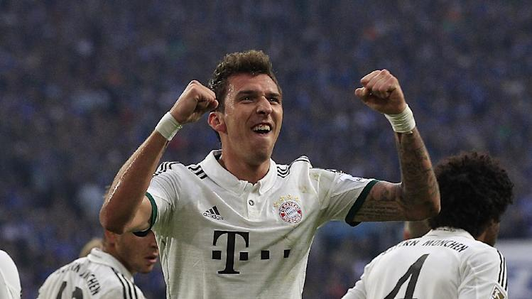 Bayern's Mario Mandzukic of Croatia celebrates after scoring during the German first division Bundesliga soccer match between Schalke 04 and Bayern Munich in Gelsenkirchen, Germany, Saturday, Sept. 21, 2013