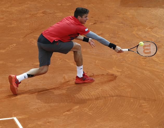 Milos Raonic of Canada, returns the ball to Stanislas Wawrinka of Switzerland during their quarterfinals match of the Monte Carlo Tennis Masters tournament in Monaco, Friday, April 18, 2014. Wawrinka