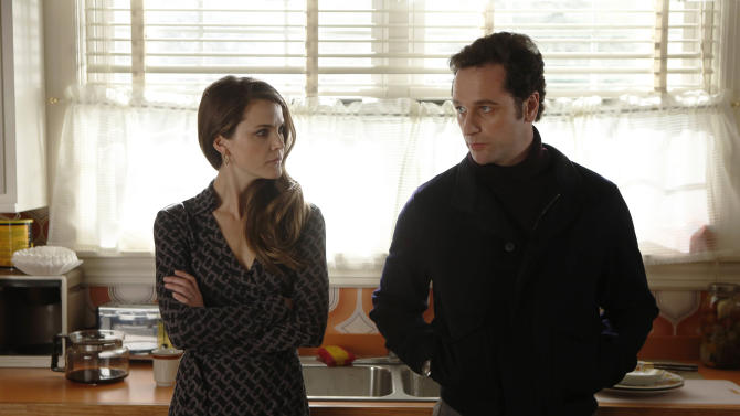 "This TV publicity image released by FX shows Keri Russell as Elizabeth Jennings, left, and Matthew Rhys as Philip Jennings in a scene from the spy drama ""The Americans."" Gandolfini's portrayal of Tony Soprano represented more than just a memorable TV character. He changed the medium, making fellow antiheroes like Walter White, Don Draper and The Jennings possible, and shifted the balance in quality drama away from broadcast television. (AP Photo/FX, Craig Blankenhorn)"