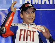 Spain's 2010 world champion Jorge Lorenzo has won the French MotoGP to take the overall lead in the championship