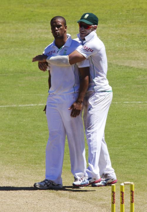 South Africa's Philander and du Plessis celebrate the wicket of Rahane during the fifth day of the second test cricket match in Durban
