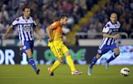Barcelona's defender Jordi Alba (C) controls the ball before scoring during their Spanish league football match against Deportivo La Coruna at Riazor Stadium in Coruna. Barcelona won 5-4