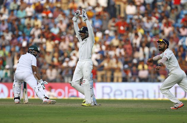 India's captain Kohli and wicketkeeper Saha unsuccessfully appeal for the wicket of South Africa's Tahir during the first day of their third test cricket match in Nagpur