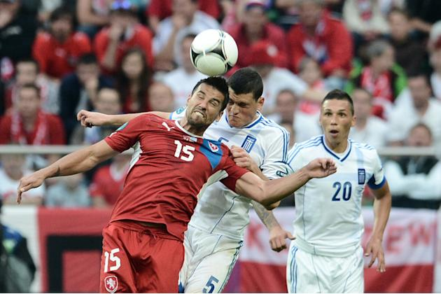 Czech Forward Milan Baros And Greek Defender Kyriakos Papadopoulos (C) Head The Ball AFP/Getty Images