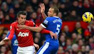 Everton's Dutch defender John Heitinga (R) tangles with Manchester United's Dutch striker Robin van Persie (L) during the English Premier League football match between Manchester United and Everton at Old Trafford, Manchester, North West England, on February 10, 2013. United won 2-0